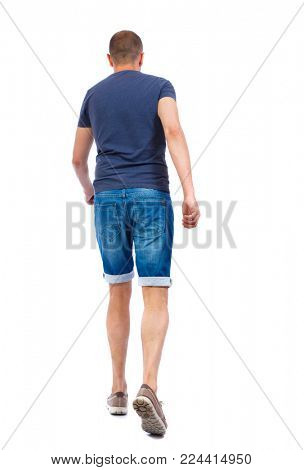 Back view of going  handsome man. walking young guy . Rear view people collection.  backside view of person.  Isolated over white background. The guy in denim shorts goes forward.