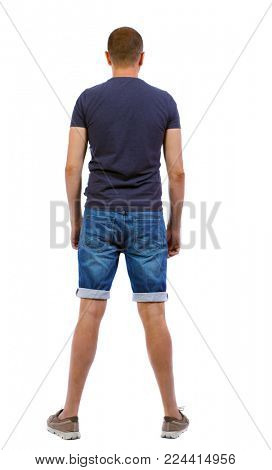 Back view of handsome man in shorts. Rear view people collection.  backside view of person.  The boy in denim shorts stands behind him.