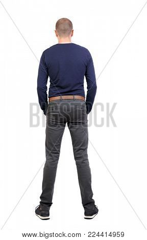 Back view of man in jeans. Standing young guy. Rear view people collection.  backside view of person.  Isolated over white background. A man in trousers and sneakers must put his hands in his pockets.