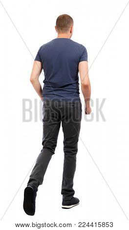 Back view of going  handsome man. walking young guy . Rear view people collection.  backside view of person.  Isolated over white background. The guy in trousers and the blue T-shirt goes side by s