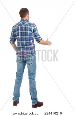 Back side view of man  in shirt handshake.  Rear view people collection.  backside view of person.  Isolated over white background. A man in a blue shirt stretches out his hand for a friendly greet