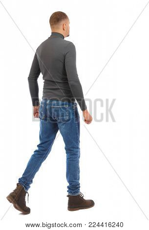 Back view of going  handsome man. walking young guy . Rear view people collection.  backside view of person.  Isolated over white background. The man in a gray sweater goes sideways.