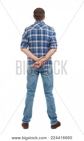 Back view of man in jeans. Standing young guy. Rear view people collection.  backside view of person.  Isolated over white background. A man in a checkered blue shirt stands holding his hands behind h