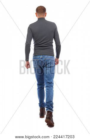 Back view of going  handsome man. walking young guy . Rear view people collection.  backside view of person.  Isolated over white background. A man in a gray sweater runs past. A man in a gray swea