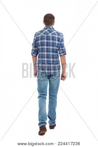 Back view of going  handsome man. walking young guy . Rear view people collection.  backside view of person.  Isolated over white background. A man in a blue shirt goes slowly.