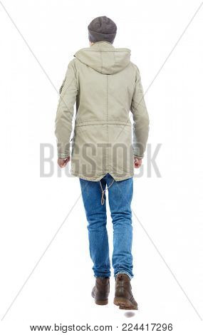 Back view of going  handsome man. walking young guy . Rear view people collection.  backside view of person.  Isolated over white background. A guy in a jacket and a hat goes forward.