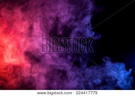 Thick colorful smoke of  purle and pink on a black isolated background. Background from the smoke of vape poster
