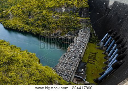 Bhumibol Dam, Concrete Arch Dam on Ping River.Hydroelectric dam Concrete structure, River in the forest.