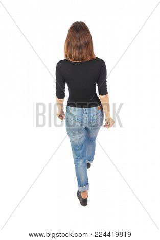 back view of walking  woman. beautiful blonde girl in motion.  backside view of person.  Rear view people collection. Isolated over white background. A top view of a girl in a black jacket goes away.
