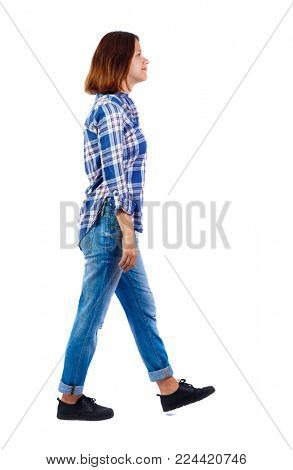 back view of walking  woman. beautiful blonde girl in motion.  backside view of person.  Rear view people collection. Isolated over white background. The girl in a blue shirt goes to the side.