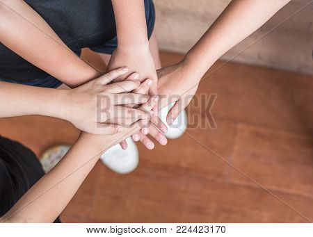 School Kid Volunteer Hands For Friendship And Community Collaboration Concept