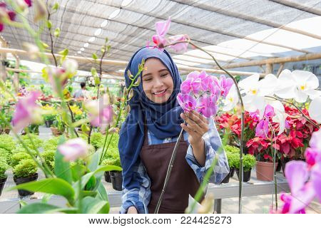portrait of young florist working on flower in the shop