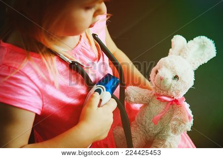 little girl play doctor or nurse with toy, measuring feaver, role playing