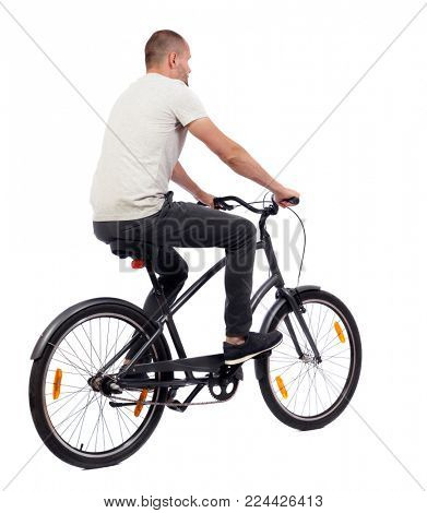 back view of a man with a bicycle. cyclist rides a bicycle. Rear view people collection.  backside view of person. Isolated over white background. A guy in a white sweater on a retro bike rides in th