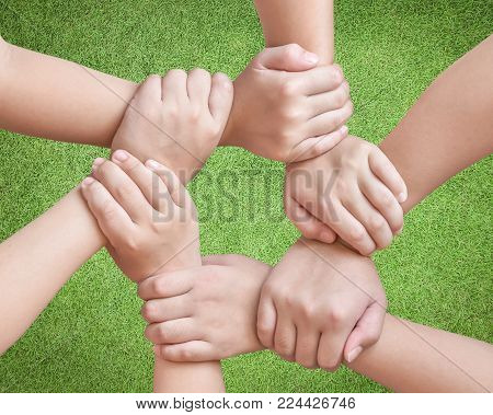 Circle of friend's unity , kid's friendship concept with isolated children's hands bonding in circle