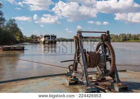 Fluvial Port: Rusted and Old Manual Naval Winch. poster