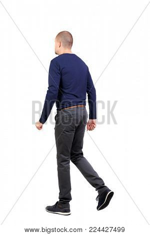 Back view of going  handsome man. walking young guy . Rear view people collection.  backside view of person.  Isolated over white background. A man in trousers and sneakers goes side by side.