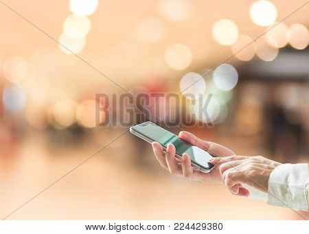 Digital Lifestyle Business Person Or Shopper Using Mobile Smart Phone For Retail Shopping In Mall An