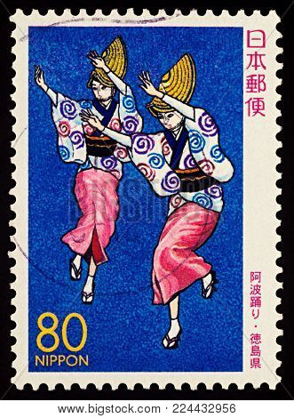 Moscow, Russia - January 31, 2018: A stamp printed in Japan shows two Japanese dancing women, Awa Odori Dancers, series