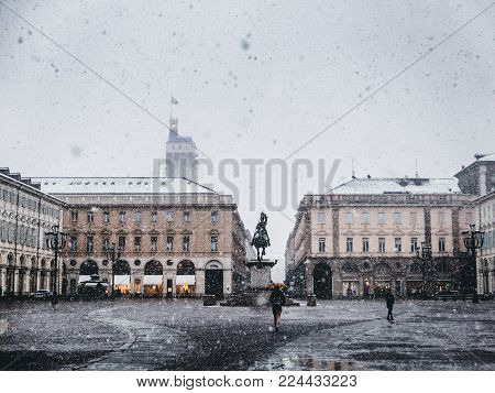 Vintage looking Piazza San Carlo royal square in Turin (Torino), Italy under the snow