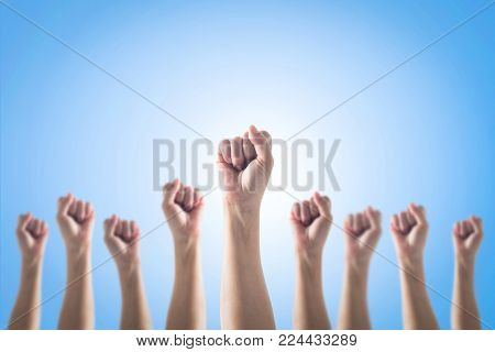 Empowering Women Power, Human Rights And Labor Day Concept With Strong Fist Hands Isolated On Blue S