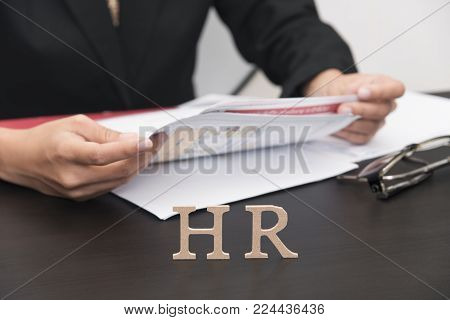 business employer holding document. concept HR and interview, hiring.