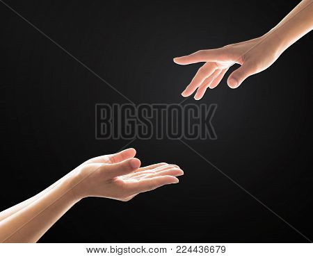 Charity donation concept with women's hand  in giving and receiving  gesture