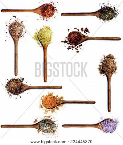 Collection of Various Spices in Wooden Spoons: Dried Paprika, Thyme, Salt with Chili, Zira, Kosher Salt, Curry Powder, Salt with Petals, Salt with Cayenne Pepper, Coriander and Cumin Powder