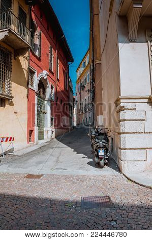 Ancient Street and motorcycle in the city of Bergamo, Italy
