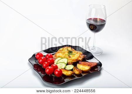Grilled steak, French fries and vegetables, on a white background