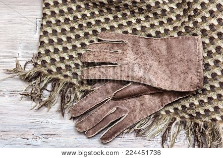 workshop on sewing gloves - top view of new hand-made sewn gloves on wool shawl