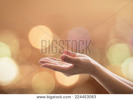 Empty female women open human hand prayer palms up Candle night light natural warm gold lantern bokeh Pray support aid destiny help peace campaign: Holy spirit week: World religion day: Eid mubarak