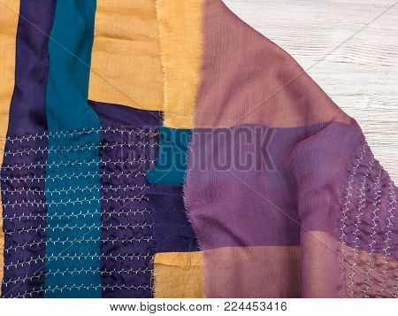 workshop on sewing a patchwork scarf - not hemmed stitched silk shawl on table