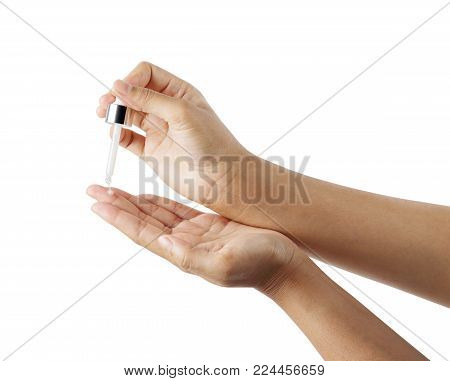 woman hand hold a spuit (dropping pipet, medicine pipette ) with liquid for chemical isolated clipping path, eyedropper or transparent glass pipette, dropper for instillation nose or eyes