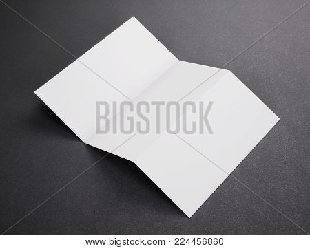 Blank white tri folded booklet mockup on dark background. Empty template booklet for your design. 3d rendering