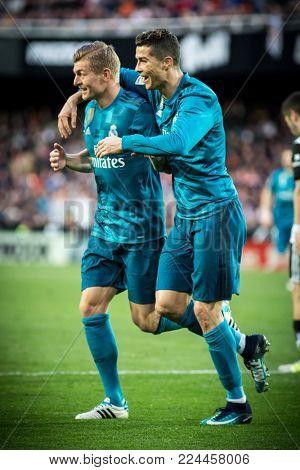VALENCIA, SPAIN - JANUARY 27: (L) kroos and Ronaldo during Spanish La Liga match between Valencia CF and Real Madrid at Mestalla Stadium on January 27, 2018 in Valencia, Spain