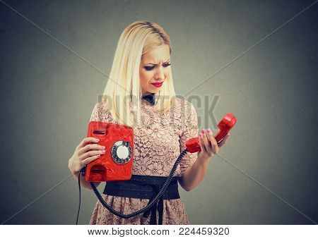 Annoyed upset woman receiving bad news on the phone