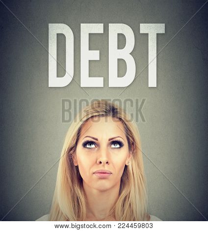 Stressed young business woman under debt pressure