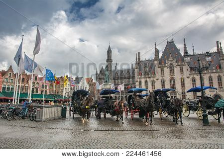 Bruges, Belgium - September 14, 2017: The Markt (Market Square) of Bruges is located in the heart of the city. Some historical highlights around the square include the 12th-century belfry and the Provincial Court.