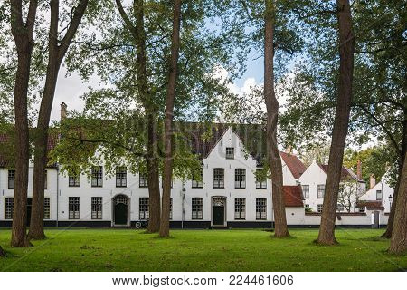 Bruges, Belgium - September 14, 2017: The Princely Beguinage Ten Wijngaerde is the only preserved beguinage in Bruges. There are no more Beguines living there, but it functions as a convent for Benedictines