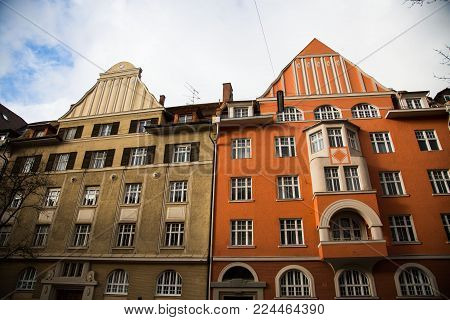 Old houses in Schwabing, orange and green facade