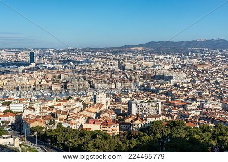 Marseille, France - December 4, 2016: Aerial panoramic view of Marseille from basilica of Notre Dame de la Garde for the old Vieux port in Marseille, Provence, France.