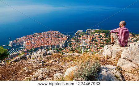 man enjoying the beautiful town of Dubrovnik from above, Croatia