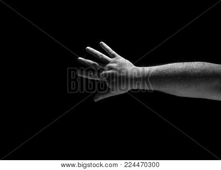 Hand gestures isolated on black background, arm