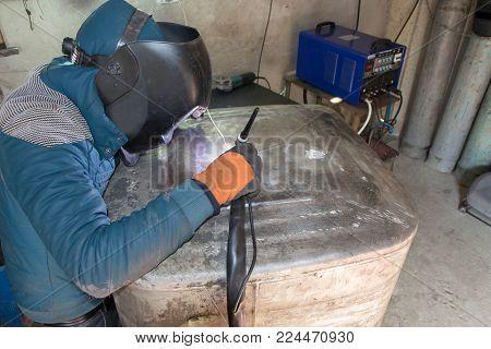 Welder argon welding for aluminum at work. Argon aluminum welding