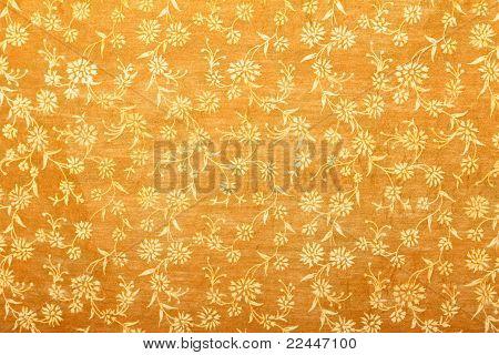 orange handmade art paper with white floral pattern