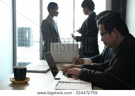 Business Adviser Analyzing Company Financial Report. Professional Investor Discussing Balance Sheet