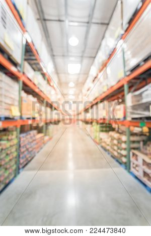 Blurred Wholesale Store With Big Boxes Of Product From Floor To Ceiling