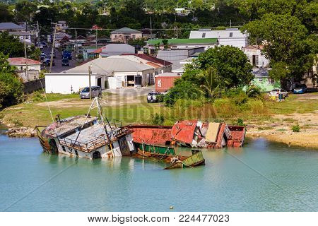 Boats damaged by hurricanes and smashed against the shore