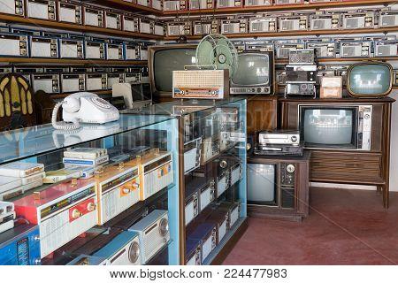 Bangkok, Thailand - Jan 14, 2018: Old vintage different radios, television and electronic in antique store shelves at Bang Yai Nonthaburi, Thailand.